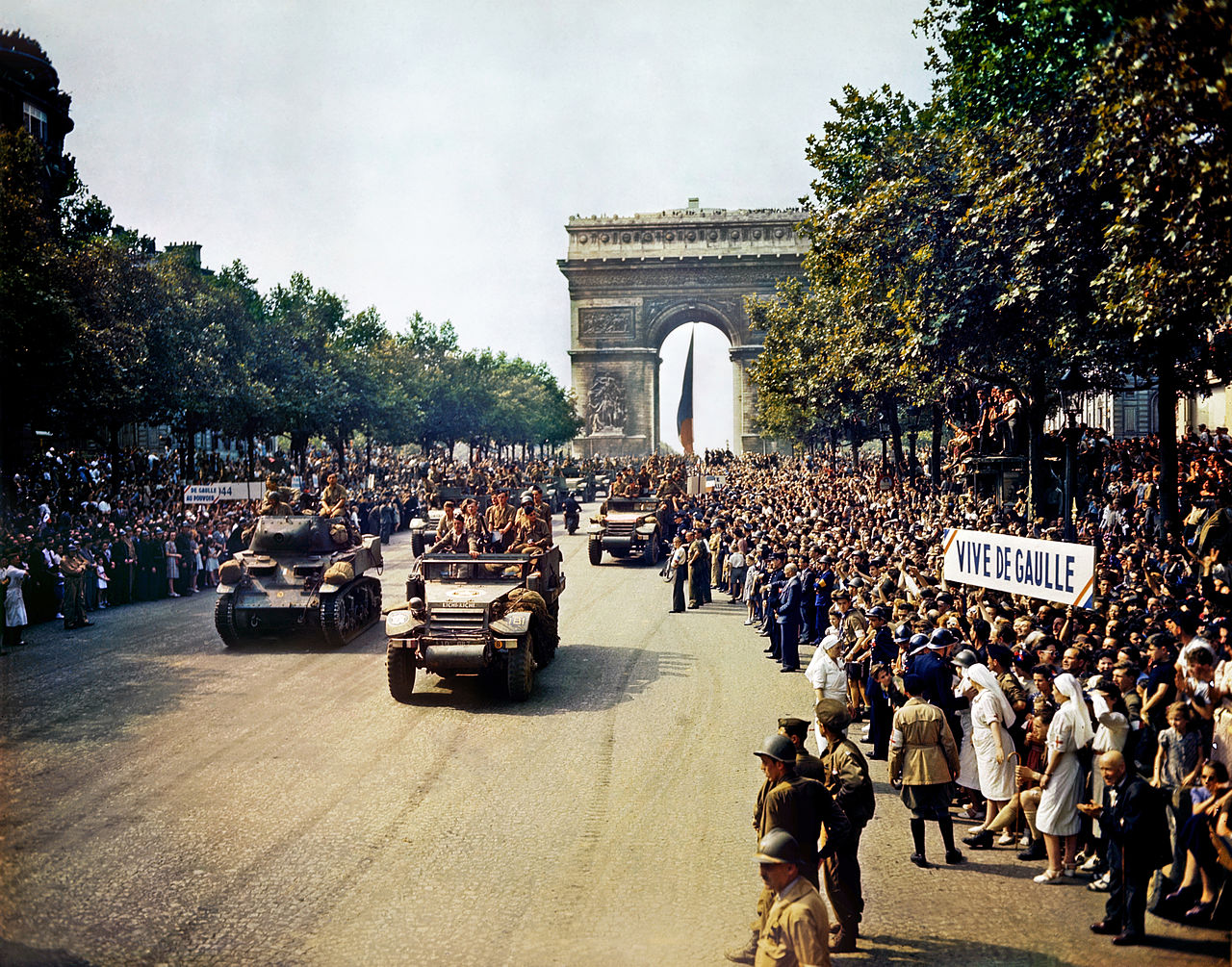 Crowds of French patriots line the Champs Elysees to view Free French tanks and half tracks of General Leclerc's 2nd Armored Division passes through the Arc du Triomphe, after Paris was liberated on August 26, 1944. Among the crowd can be seen banners in support of Charles de Gaulle. Photo taken by Jack Downey, U.S. Office of War Information. From the Library of Congress Prints and Photographs Division Washington, D.C. 20540 - reproduction number LC-DIG-fsac-1a55001 (digital file from original transparency)