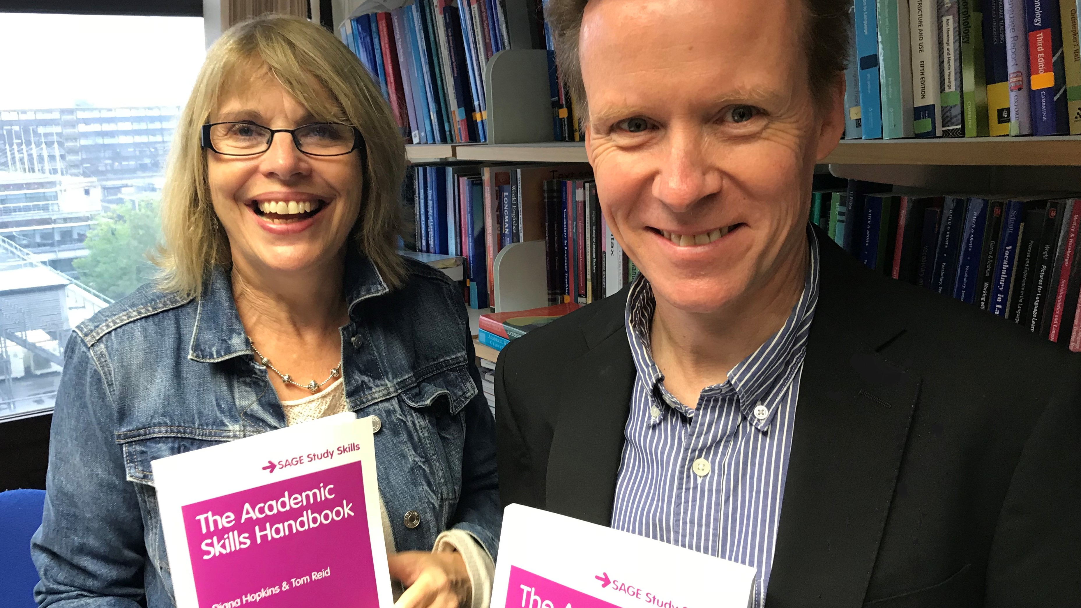 Diana Hopkins and Tom Reid holding copies of The Academic Skills Handbook