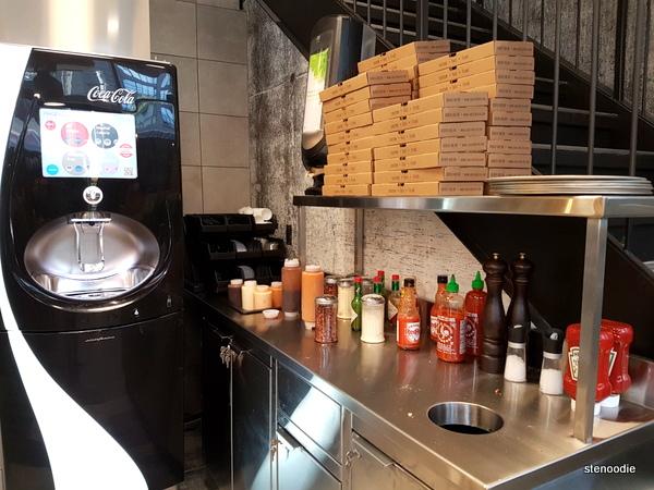 Za Pizza Bistro drinks and sauce station
