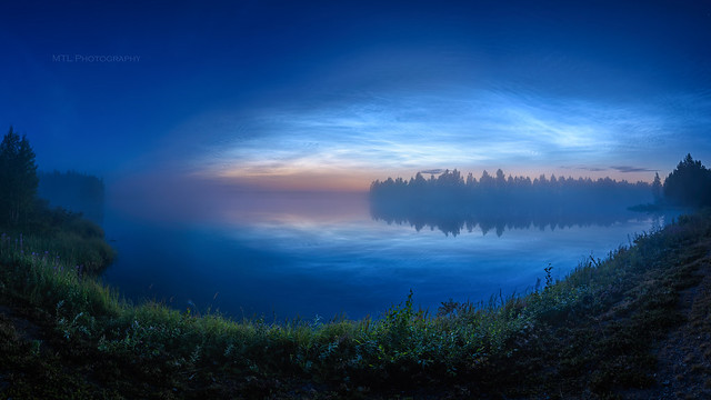 Misty river and noctilucent clouds