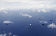 Military Sealift Command ships steam in formation off the coast of Guam during a group sail exercise, Aug. 13. (U.S. Navy/MC3 Randall W. Ramaswamy)