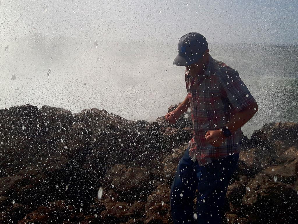 wave splashing on Praia do Bordeira, Portugal