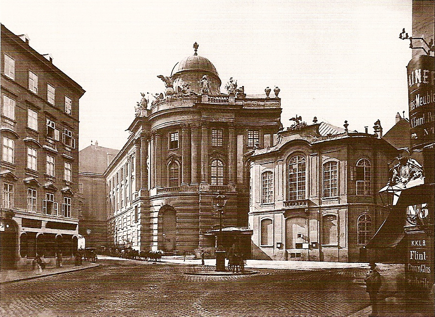 The old Burgtheater on Michaelerplatz and Winterreitschule in Vienna, circa 1887.
