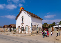 Children walking in front of an old portuguese colonial house, Benguela Province, Catumbela, Angola