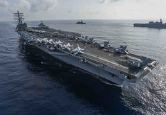 In this file photo, ships of the Ronald Reagan Strike Group and Japan Maritime Self-Defense Force steam in formation during a bilateral exercise in the South China Sea in August. (U.S. Navy/MC2 Kaila V. Peters)