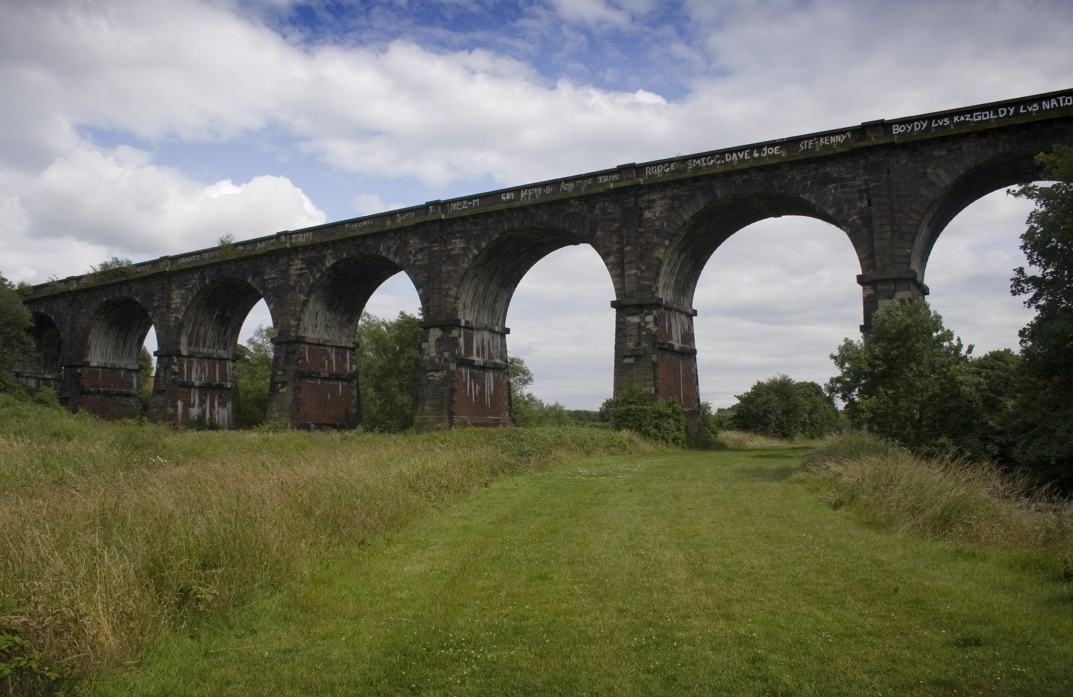 Stephenson's viaduct crosses the Sankey Brook, and the remains of the Sankey Canal. The viaduct is in use to this day. Photo taken on July 13, 2009.