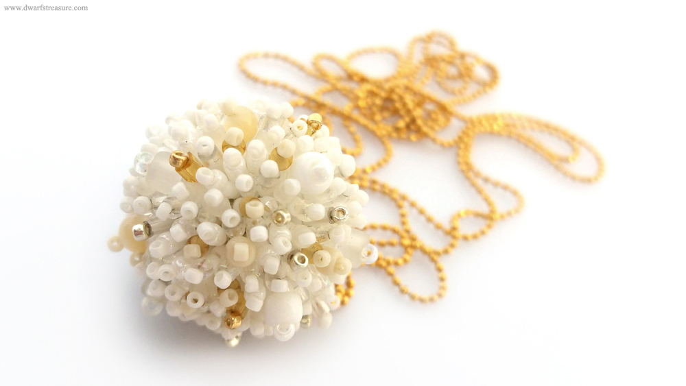 stylish white fluffy beaded ball
