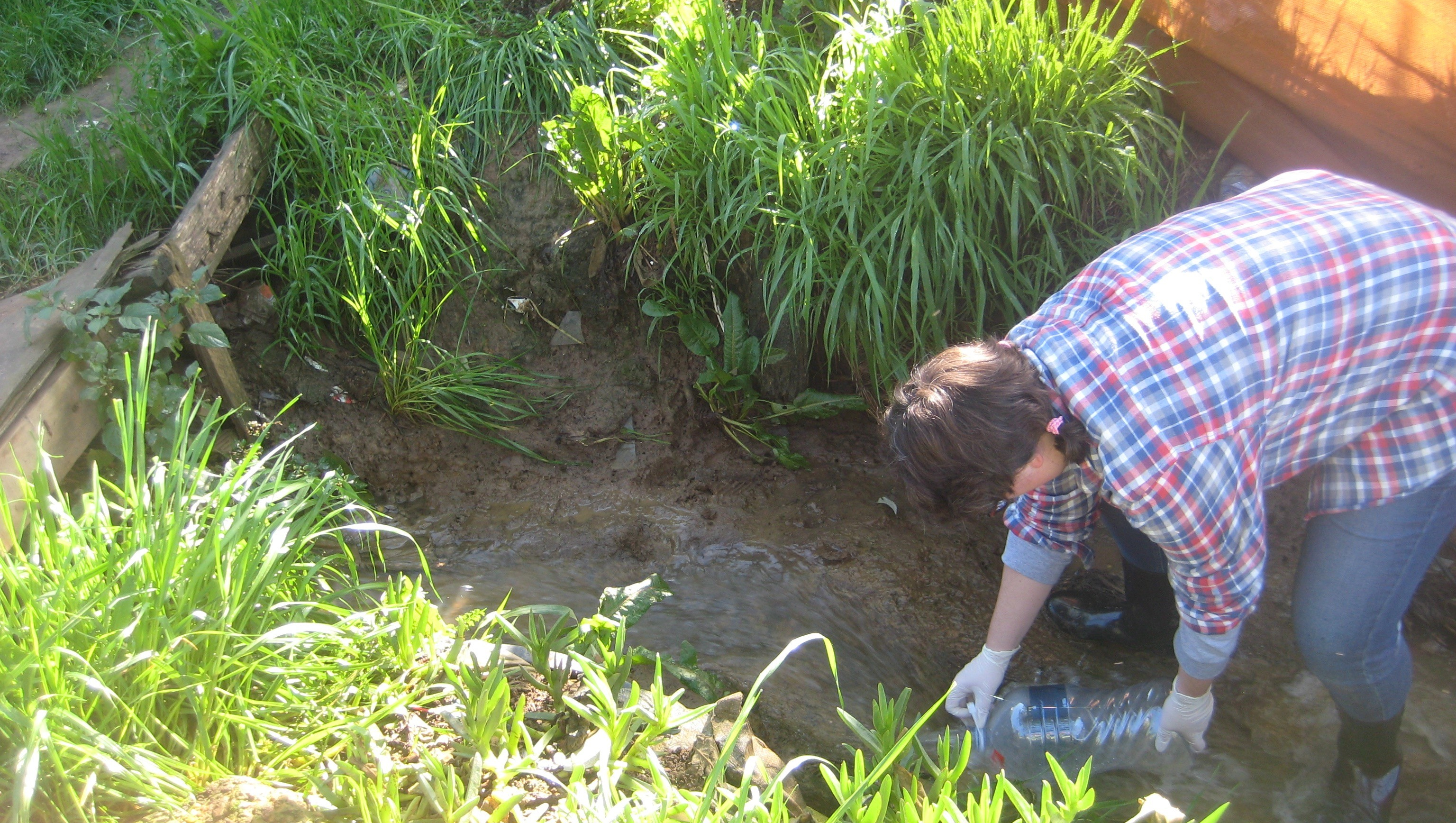 Olivia taking water samples in Enkanini, South Africa.
