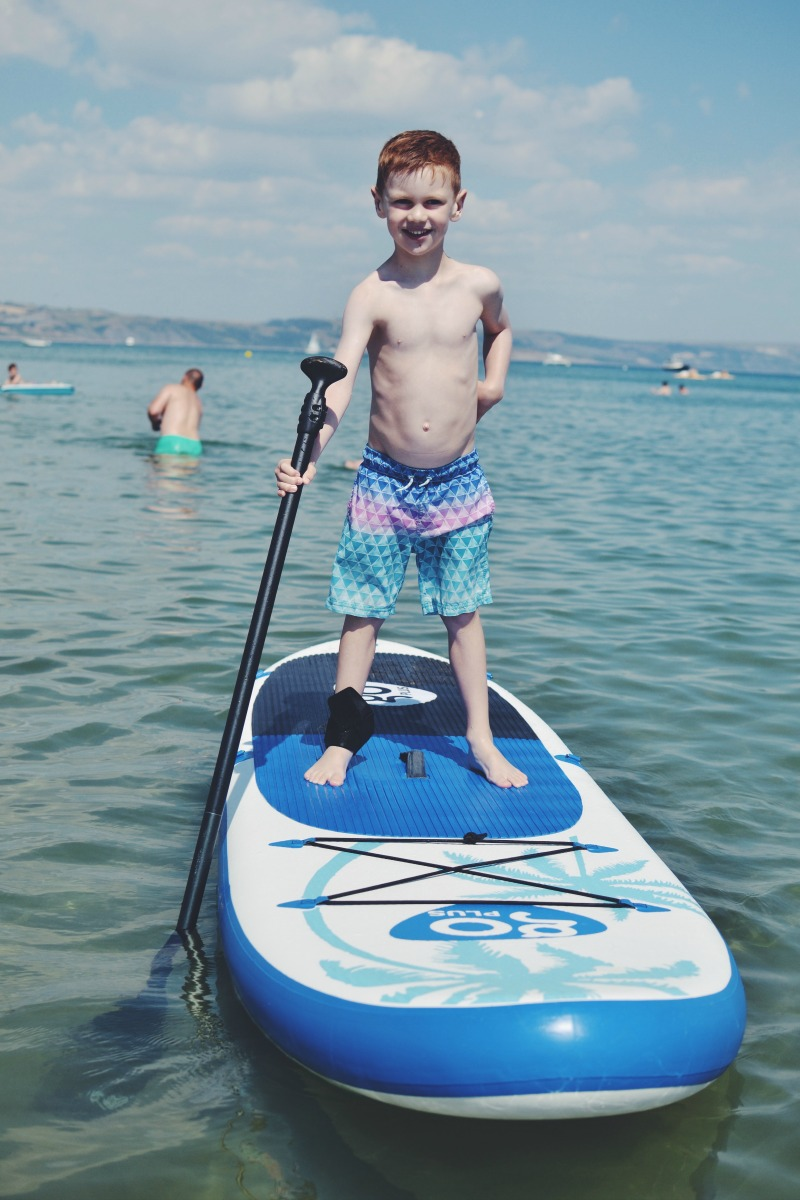 M Stand paddleboarding