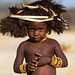 Cute mucubal tribe boy wearing a fur headwear, Namibe Province, Virei, Angola by Eric Lafforgue