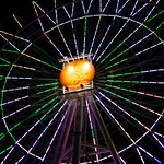 View of the Ferris Wheel at American Village at night