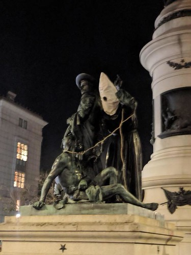 Early Days statue with KKK hood