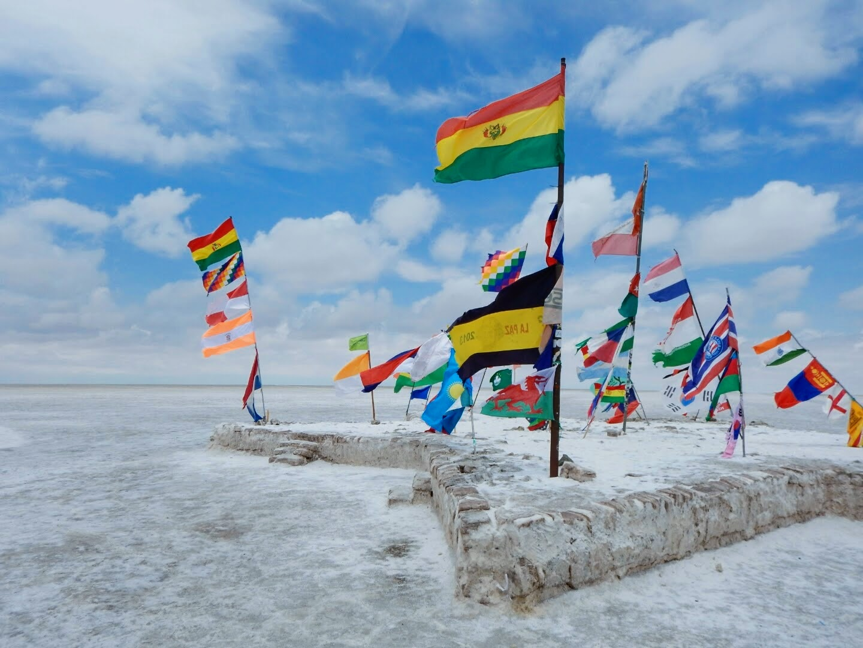 Flags at the center of Salar de Uyuni