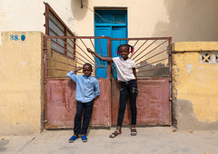 Children in front of a portuguese colonial house, Benguela Province, Catumbela, Angola