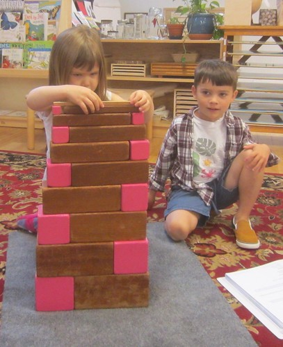 carefully constructing pink and brown patterns