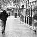 Man looking at woman in the rain by Martyn.Hayes