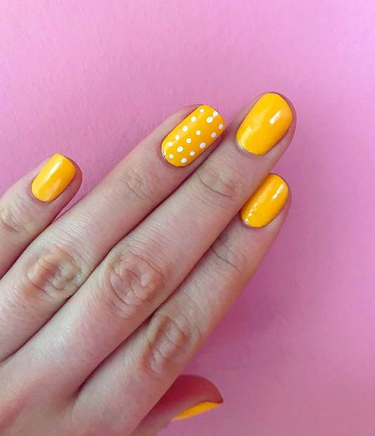 VIBRANT YELLOW AND POLKA DOT NAILS