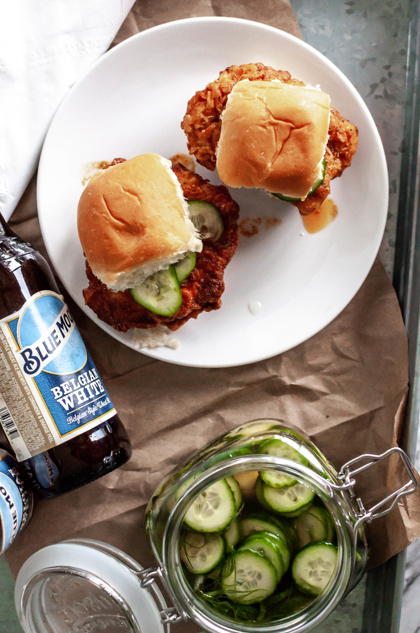 Hot Chicken Sliders with Quick Pickles are the ultimate game day food. Soft, buttery bread, crispy fried chicken, spicy sauce and fresh, crunchy pickles.