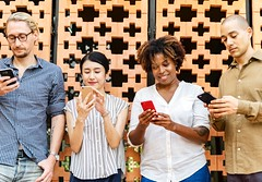 Four People Holding Mobile Phones - Credit to https://www.semtrio.com/