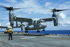 Marines and Sailors of the 31st Marine Expeditionary Unit and the amphibious assault ship USS Wasp (LHD 1) take off aboard an MV-22B Osprey to conduct surveys on the islands of Guam and Saipan, Sept. 9. (U.S. Marine Corps/Cpl. Alexis B. Betances)