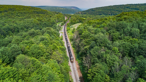 drone emdsd40e ns6323 nspittsburghline nsi1m newportagerailroad newportagetunnel norfolksouthern theslide tunnelhill aerial aerialphotography dronephotography helper i1m overlook railroad trains tunnel
