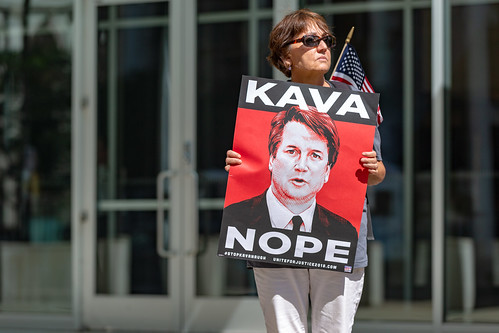 A protester against the confirmation of U.S. Supreme Court nominee Brett Kavanaugh outside the Warren E. Burger Federal Building in St. Paul, Minnesota