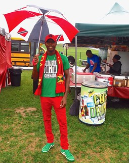 Trini Umbrella, Grenada clothes in front of Jamaican Food Booth