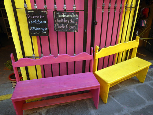 Bright pink and yellow benches in Puebla, a UNESCO Heritage site in Mexico