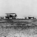 A 1st Aero Squadron Curtiss R–2 takes off in front of tent aircraft hangers at Columbus, NM. (Photo/United States Army Air Service)