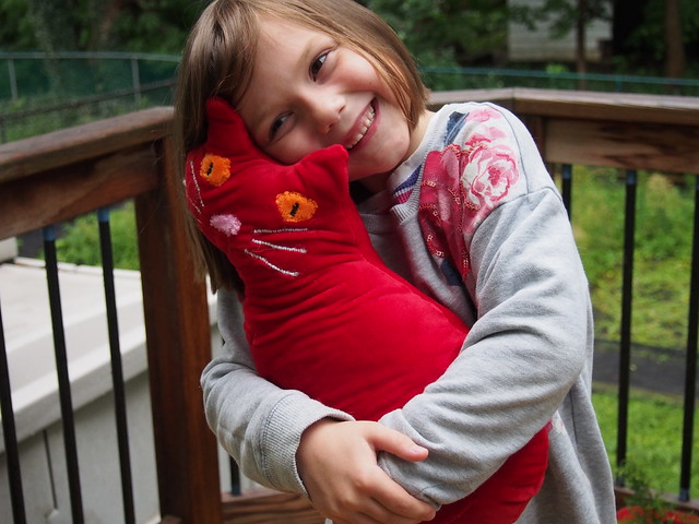 Happy kiddo with her weighted kitty.