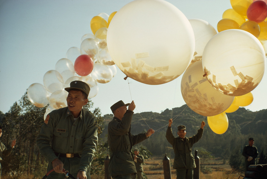 To spread political views, soldiers release balloons holding leaflets in Taiwan, January 1969.Photograph by Frank and Helen Schreider, National Geographic