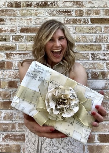 Repurposing book pages into beautiful gift wrapping.  Artist Bridget Fox