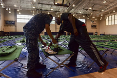 Morale Welfare and Recreation employees and Joint Base Pearl Harbor-Hickam personnel go over emergency preparation kits at the base fitness center as Hurricane Lane approaches Hawaii. (U.S. Navy/MC1 Corwin M. Colbert)