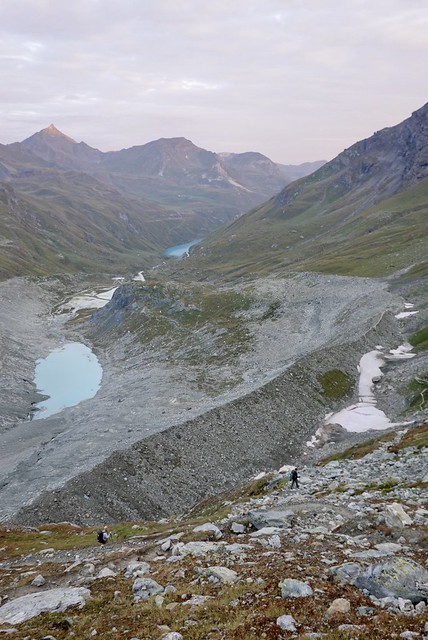 Down the sides of the retreating glacier
