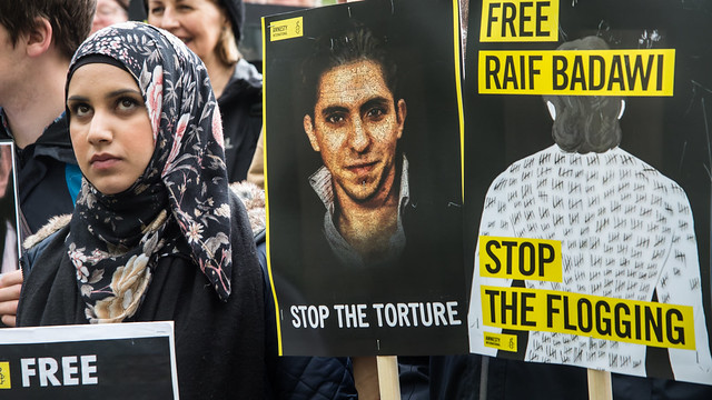 Woman protesting the release of activist from Saudi Arabia