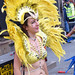 DSC_8537a Notting Hill Caribbean Carnival London Exotic Colourful Yellow Costume with Feather Headdress Girls Dancing Showgirl Performers Aug 27 2018 Stunning Ladies