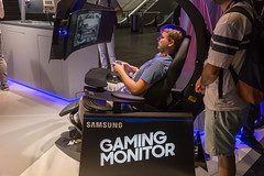 Gamer sitting in a gaming chair and playing on a super ultra-wide monitor