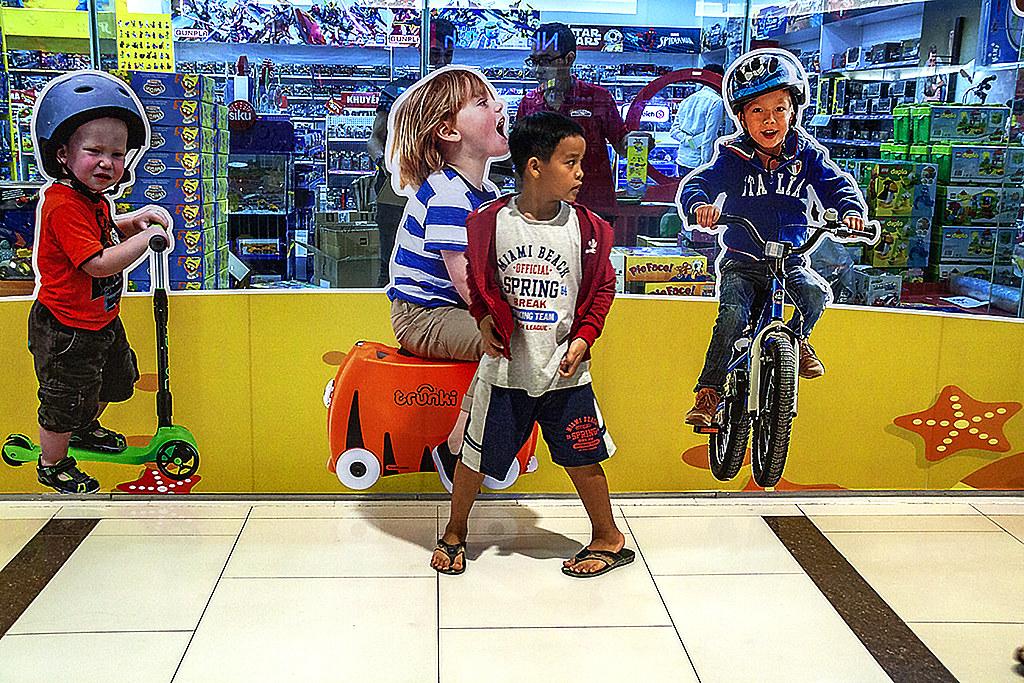 White kids and a Vietnamese kid--Saigon