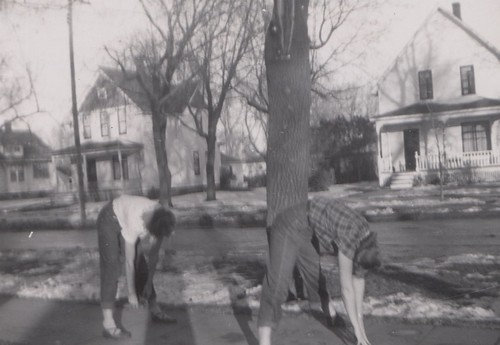 Bev Hobbs and Marilyn in football stance, ca. 1951