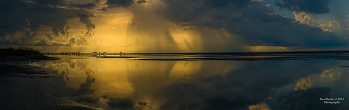 united states charleston sc isle palms private beach flooded storm beautiful fierce sunrise mirror reflection water standing sunny cloudy glow rain island moody dark thunder lightning sun light yellow blue black clouds shore panorama panoramic usa