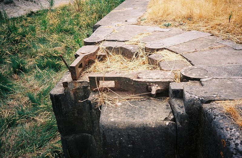 Lock gate mechanisms