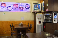 Watching news in a Korean restaurant