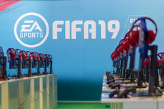 Gaming PCs with red headphones at the EA FIFA19 booth