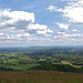 View east from the Herefordshire Beacon towards Bredon Hill an outlying spur of the Cotswold escarpment.