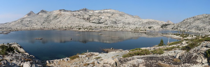 Panorama and reflections on Lake Aloha of the Crystal Range with Pyramid Peak and Mount Price
