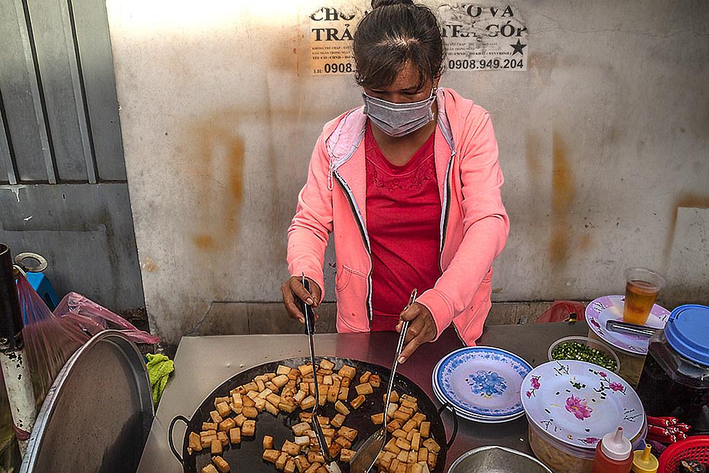 Woman preparing bot chien--Saigon