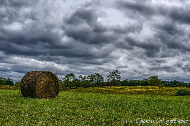 Hay Bale and Stormy Sky