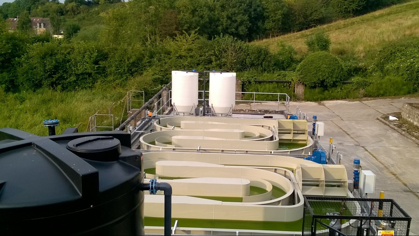 Panoramic view of the HRAP trial at Beckington STW. At the foreground the header tank and CO2 cage are visible followed by the HRAP units and at the background, the settling tanks are visible.