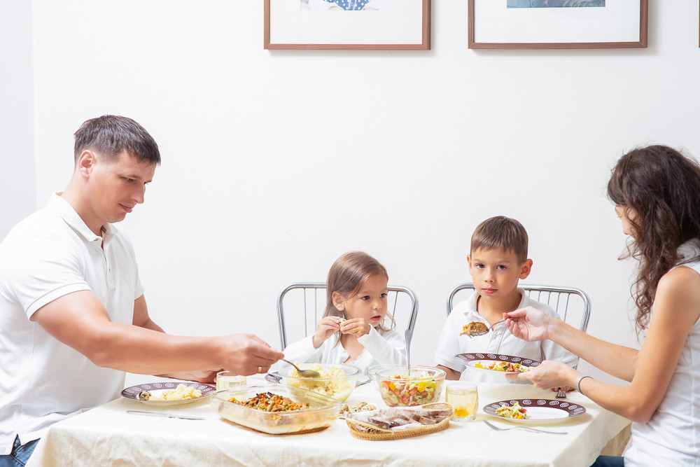 Family Concepts and Ideas of Combined Eating. Happy Parents with Their Children Having Breakfast at Home Together