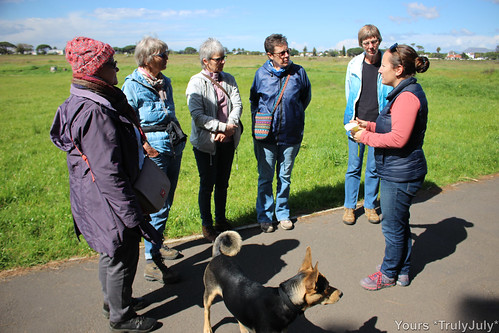 Participants of the Flower Ramble listen to an interesting introduction to Rondebosch Common.